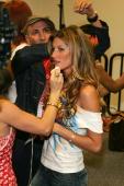 Victoria's Secret model Gisele Bundchen gets her makeup touched up backstage during the Miami Heat vs Washington Wizards game on November 9 2004 at...
