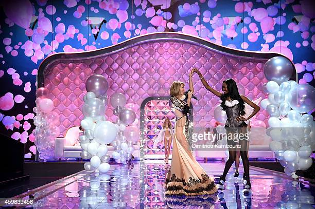 Victoria's Secret model Maria Borges walks the runway by singer Taylor Swift during the 2014 Victoria's Secret Fashion Show at Earl's Court...