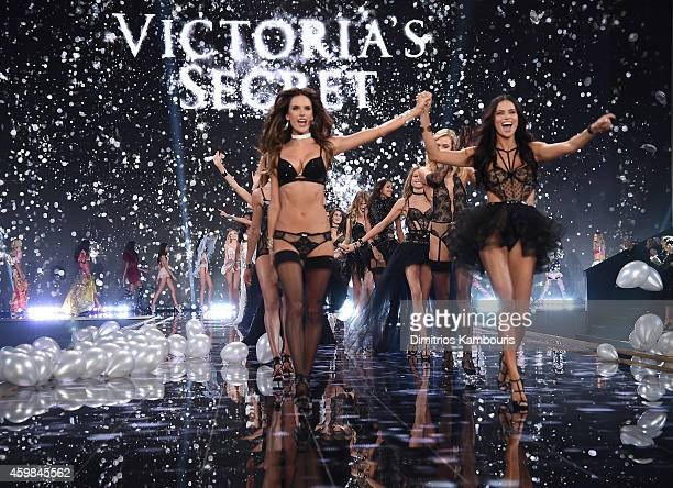 Victoria's Secret models Alessandra Ambrosio and Adriana Lima walk the runway during finale of the 2014 Victoria's Secret Fashion Show at Earl's...