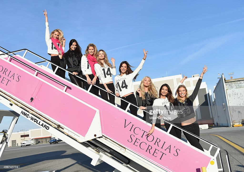 Victoria's Secret Models Candice Swanepoel, Adriana Lima, Doutzen Kroes, Behati Prinsloo, Alessandra Ambrosio, Elsa Hosk, Lily Aldridge, and Karlie Kloss depart for London for the 2014 Victoria's Secret Fashion Show at JFK Airport on November 30, 2014 in New York City.