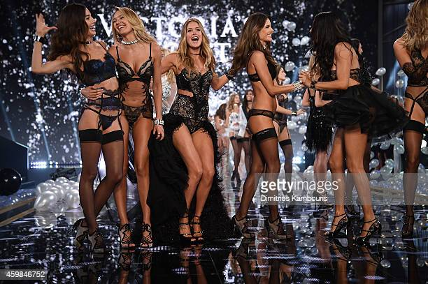 Victoria's Secret models Lily Aldridge Candice Swanepoel Doutzen Kroes and Alessandra Ambrosio walks the runway during finale of the 2014 Victoria's...