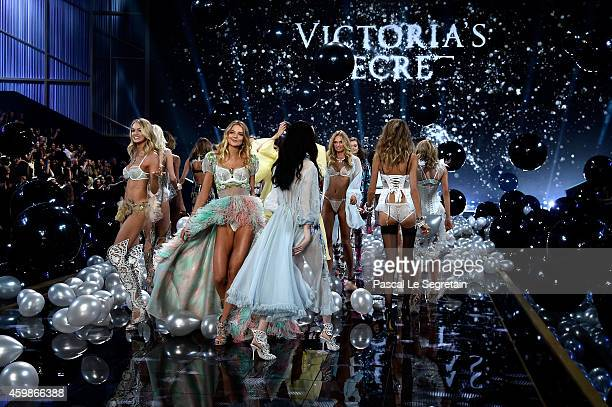Victoria's Secret models walk the runway at the annual Victoria's Secret fashion show at Earls Court on December 2 2014 in London England
