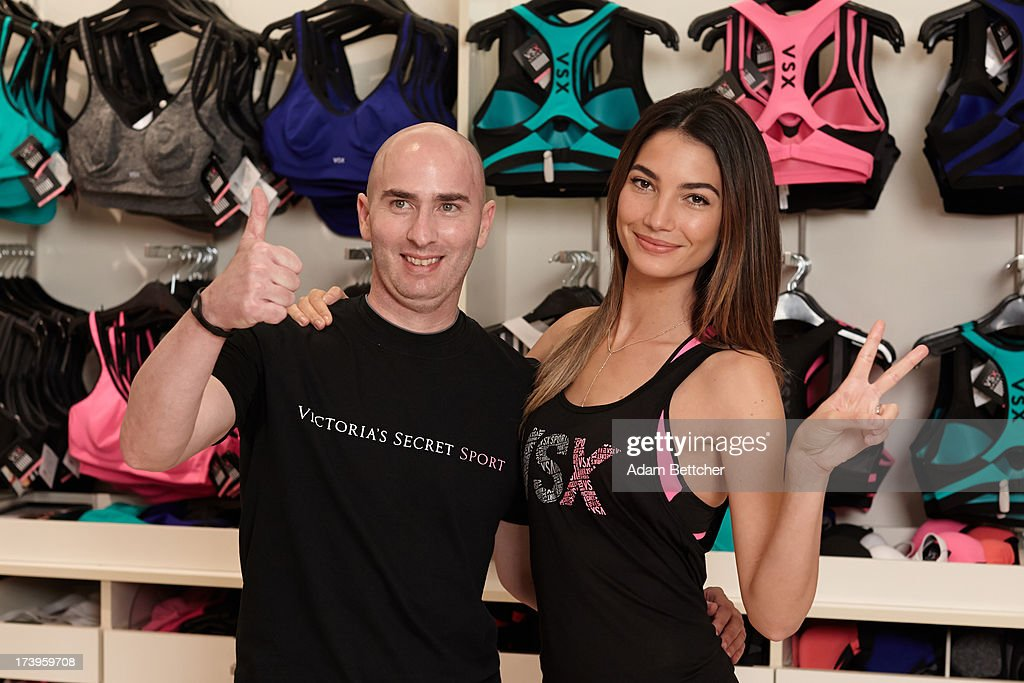 Victoria's Secret Supermodel <a gi-track='captionPersonalityLinkClicked' href=/galleries/search?phrase=Lily+Aldridge&family=editorial&specificpeople=2110490 ng-click='$event.stopPropagation()'>Lily Aldridge</a> and trainer Justin Gelband make an appearance at Rosedale Mall on July 17, 2013 in Roseville, Minnesota.