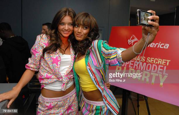 Victoria's Secret supermodels Miranda Kerr and Selita Ebanks take a selfportrait prior to boarding the first ever inflight PJ party and fashion show...
