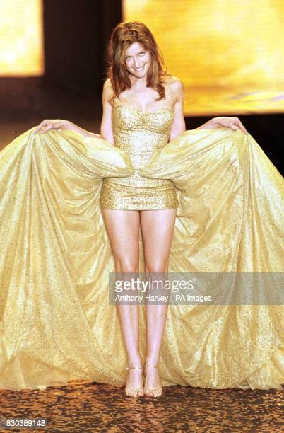 Victoria's Secrets model Laetitia Casta takes to catwalk during the amFAR fashion show in Cannes during the Cannes Film Festival