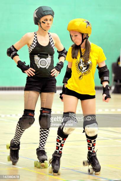 VicToriBee of Manchester Roller Derby takes on Little Daria Dynamite of Liverpool Roller Birds in 'Malice In Wonderland' bout at Greenbank Sports...