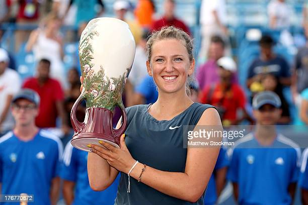 Victorioa Azarenka of Belarus poses for photographers at the trophy ceremony after defeating Serena Williams during the final of the Western Southern...