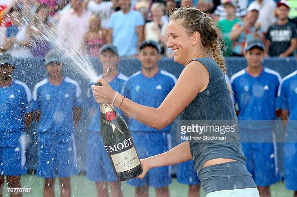 Victorioa Azarenka of Belarus sprays champagne at the trophy ceremonyt after defeating Serena Williams during the final of the Western Southern Open...