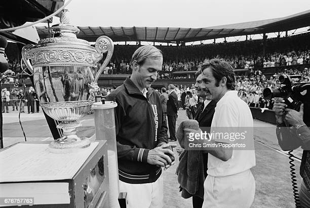 Victorious Australian tennis player John Newcombe pictured talking with defeated American tennis player Stan Smith beside the Gentlemen's Singles...