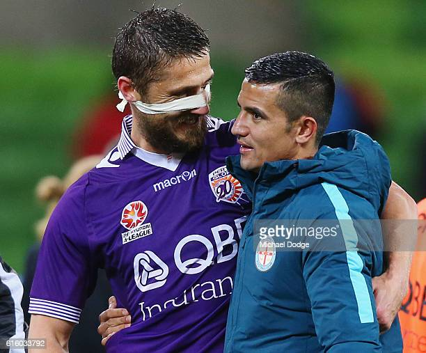 A victorious Dino Dulbic of the Glory hugs Tim Cahill of the City during the round three ALeague match between Melbourne City FC and Perth Glory at...