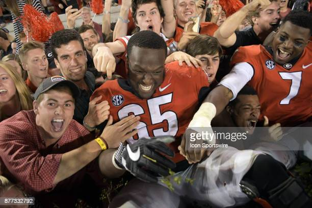 A victorious Georgia Bulldogs offensive linemen Kendall Baker celebrates with fans after the game between the Kentucky Wildcats and the Georgia...