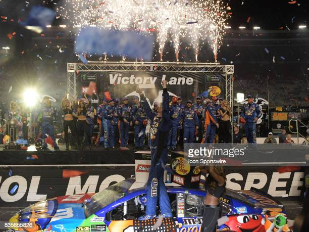 A victorious Kyle Busch Joe Gibbs Racing MM's Caramel Toyota Camry after winning the NASCAR Monster Energy Cup Series Bass Pro Shops NRA Night Race...