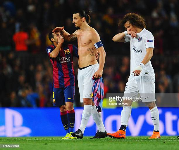 A victorious Pedro of Barcelona embraces Zlatan Ibrahimovic of PSG as David Luiz of PSG looks dejected during the UEFA Champions League Quarter Final...