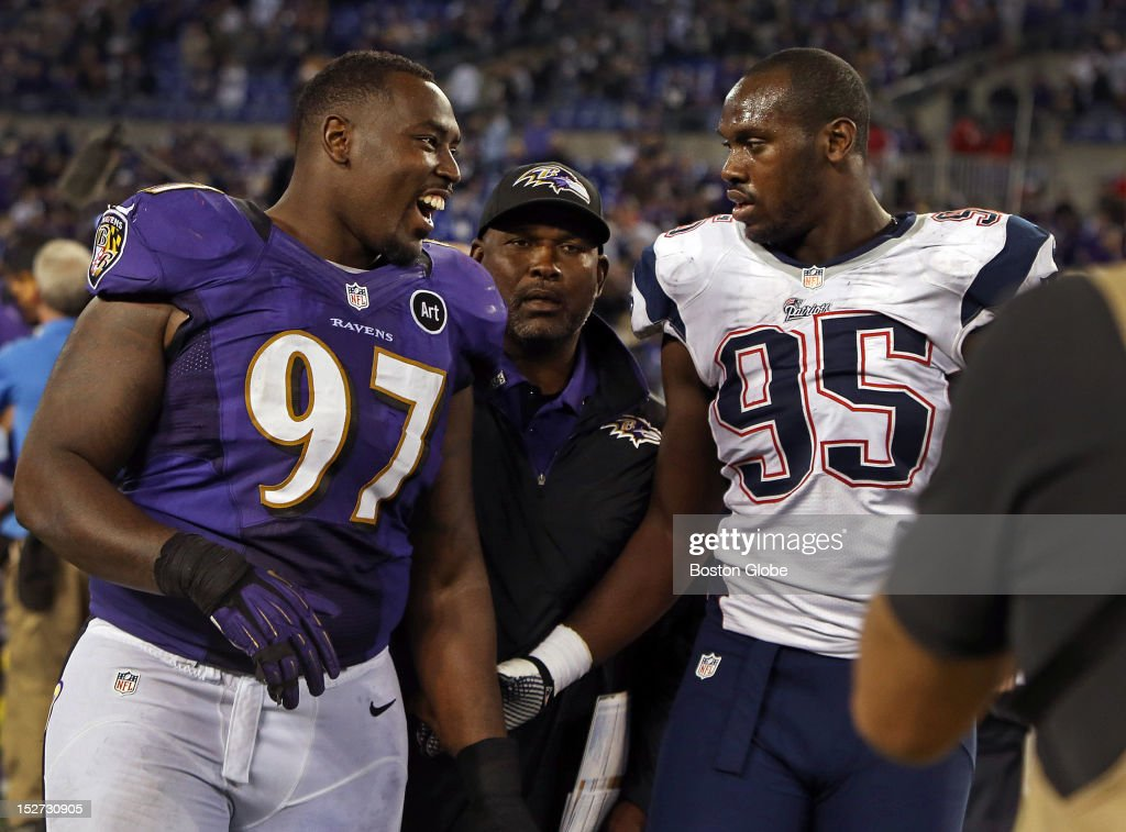 Victorious Ravens defensive lineman Arthur Jones (#97), left, has a smile and a hand shake for his younger brother, Patriots rookie defensive lineman Chandler Jones (#95), right, following Baltimore's victory over New England as the New England Patriots visited the Baltimore Ravens in a regular season NFL game at M&B Stadium.