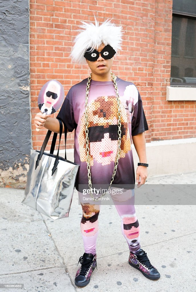 Victor-John Villanueva is seen outside the Jeremy Scott show wearing a 3PTPOP outfit on September 11, 2013 in New York City.
