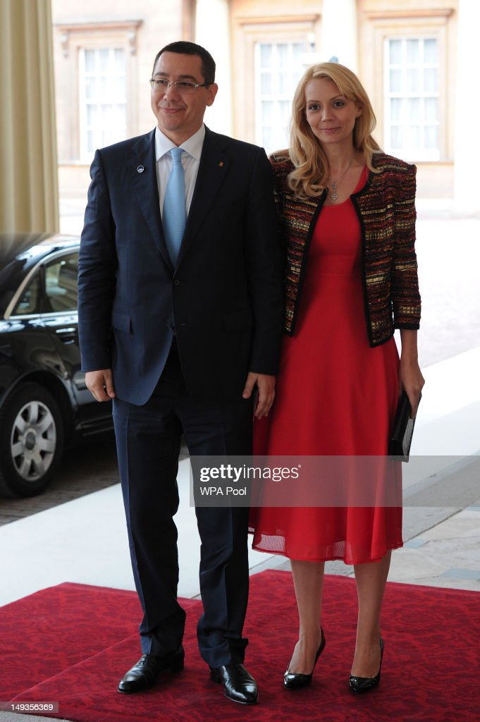 Victor-Viorel Ponta, the Prime Minister of Romania and his wife Daciana Sârbu, arrive for a London 2012 Olympic Games reception, hosted by Britain's Queen Elizabeth II, at Buckingham Palace on July 27, 2012 in London, England.