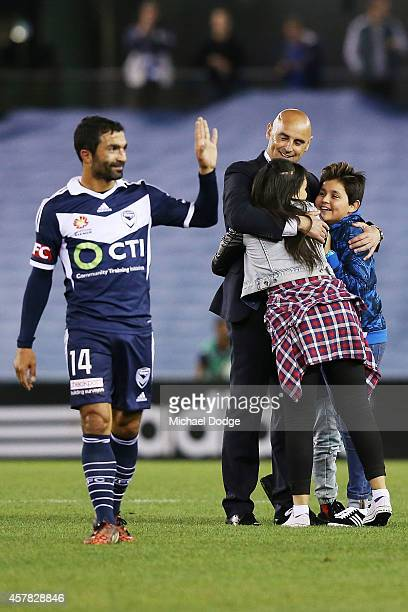 Victory coach Kevin Muscat celebrates the win with his kids during the round three ALeague match between the Melbourne Victory and Melbourne City at...