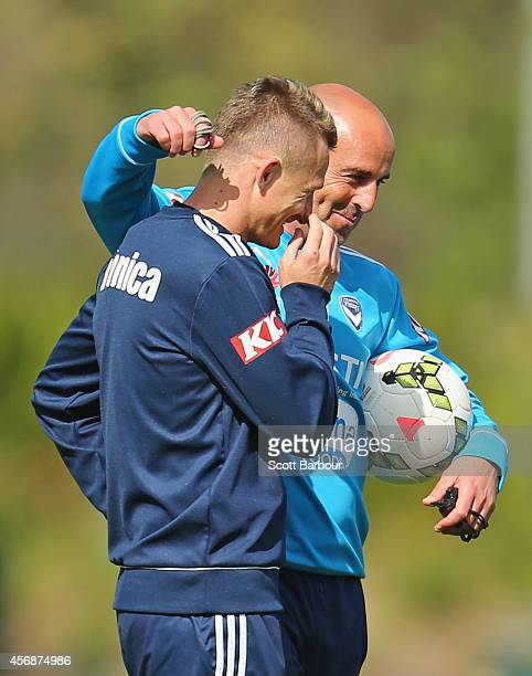 Victory coach Kevin Muscat puts his arm around Besart Berisha during a Melbourne Victory ALeague training session at Gosch's Paddock on October 9...
