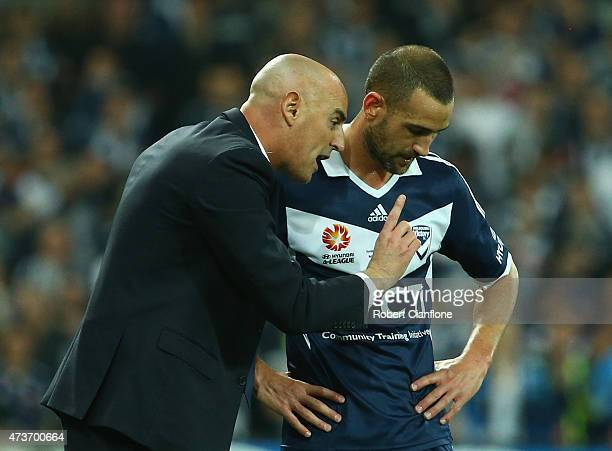 Victory coach Kevin Muscat speaks to Carl Valeri of the Victory during the 2015 ALeague Grand Final match between the Melbourne Victory and Sydney FC...