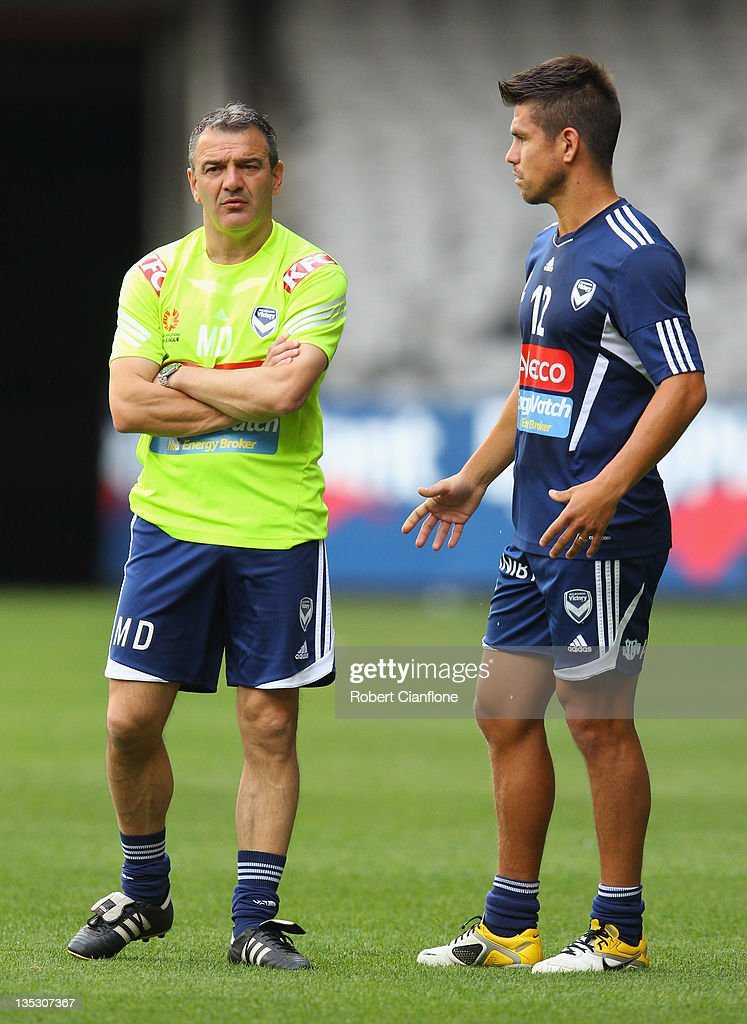 Victory coach Mehmet Durakovic talks with <a gi-track='captionPersonalityLinkClicked' href=/galleries/search?phrase=Rodrigo+Vargas&family=editorial&specificpeople=793290 ng-click='$event.stopPropagation()'>Rodrigo Vargas</a> during a Melbourne Victory A-League training session at Etihad Stadium on December 9, 2011 in Melbourne, Australia.