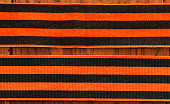 Victory Day symbol. May 9. St.Georges Ribbon. Brown strip on a black background. Symbol of a smoke and flame.