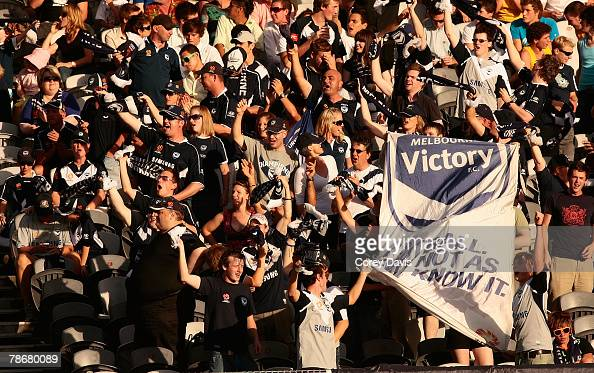 Victory fans celebrate a goal during the round 18 ALeague match between the Central Coast Mariners and the Melbourne Victory at Bluetongue Stadium on...