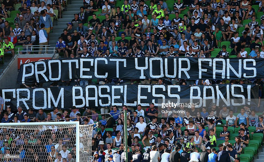 Victory fans hold up signs in protest during the round 23 A-League match between the Melbourne Victory and the Newcastle Jets at AAMI Park on March 3, 2013 in Melbourne, Australia.