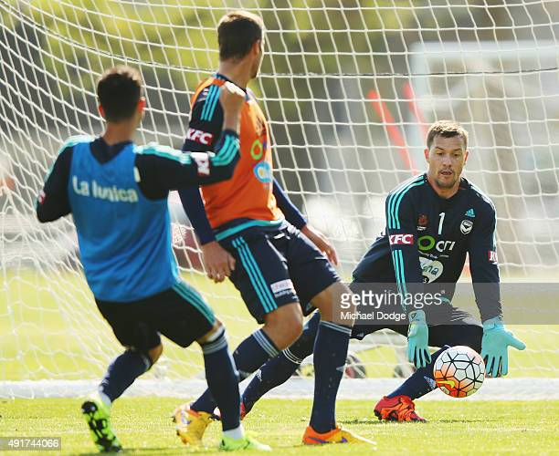 Victory goalkeeper Danny Vukovic stops a kick at goal during a Melbourne Victory ALeague training session at AAMI Park on October 8 2015 in Melbourne...