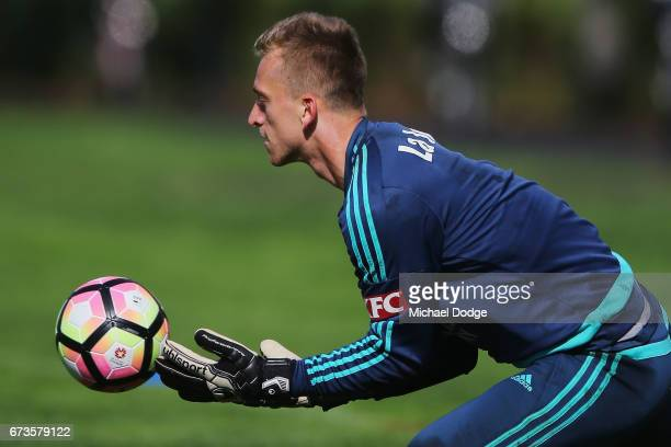 Victory goalkeeper Lawrence Thomas hurts a finger when stopping this ball during a Melbourne Victory ALeague training session at Gosch's Paddock on...