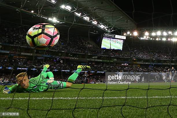 Victory goalkeeper Lawrence Thomas is beaten by a shot from Tim Cahill of Melbourne City during the round two ALeague match between Melbourne Victory...