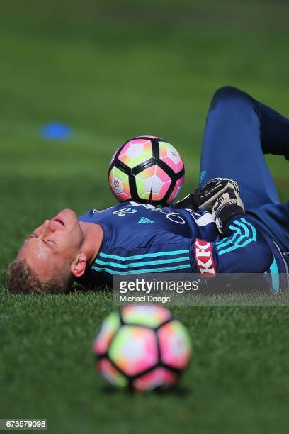 Victory goalkeeper Lawrence Thomas reacts after hurting a finger when stopping the ball during a Melbourne Victory ALeague training session at...