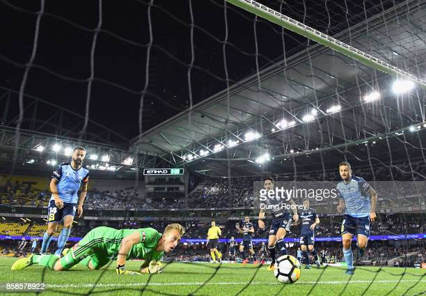 Victory goalkeeper Lawrence Thomas watches the ball go over the goal line after a pass from Luke Wilkshire of Sydney FC during the round one ALeague...