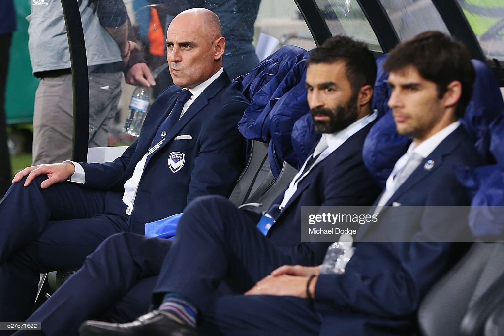 Victory head coach <a gi-track='captionPersonalityLinkClicked' href=/galleries/search?phrase=Kevin+Muscat&family=editorial&specificpeople=242953 ng-click='$event.stopPropagation()'>Kevin Muscat</a> (L) looks on next to Ben Khalfallah (C) and Guilherme Finkler of the Victory during the AFC Champions League match between Melbourne Victory and Gamba Osaka at AAMI Park on May 3, 2016 in Melbourne, Australia.