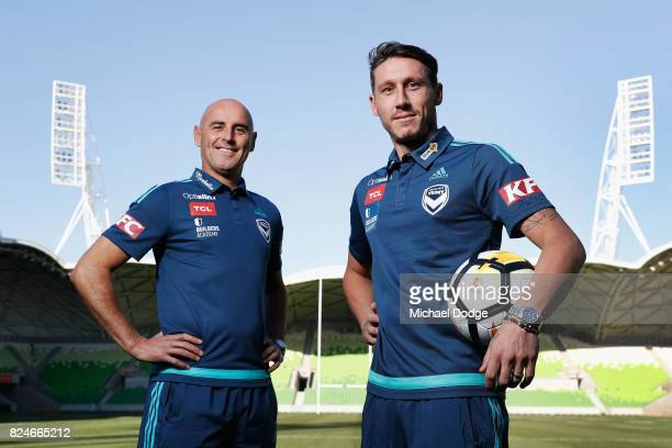 Victory head coach Kevin Muscat poses with recruit Mark Milligan during a Melbourne Victory ALeague media announcement at AAMI Park on July 31 2017...