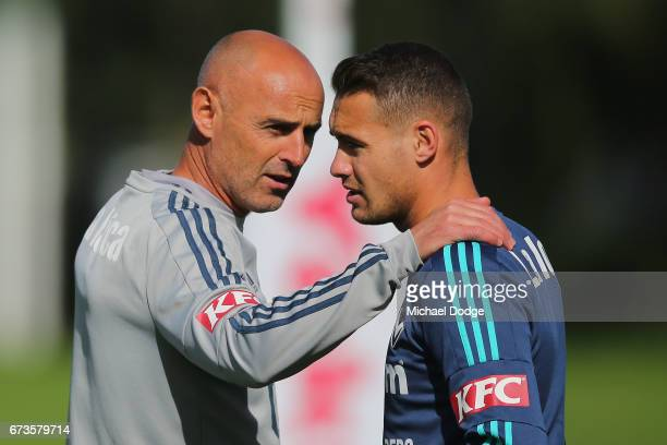 Victory head coach Kevin Muscat speaks to Jai Ingham of the Victory during a Melbourne Victory ALeague training session at Gosch's Paddock on April...