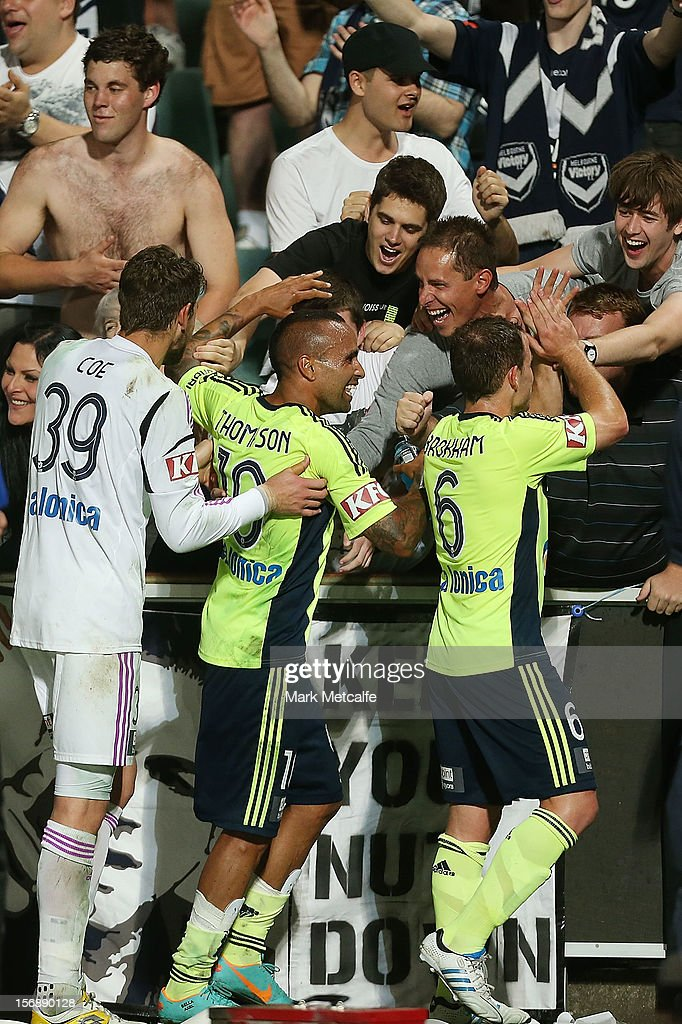 Victory players <a gi-track='captionPersonalityLinkClicked' href=/galleries/search?phrase=Archie+Thompson&family=editorial&specificpeople=545649 ng-click='$event.stopPropagation()'>Archie Thompson</a> and <a gi-track='captionPersonalityLinkClicked' href=/galleries/search?phrase=Leigh+Broxham&family=editorial&specificpeople=4103215 ng-click='$event.stopPropagation()'>Leigh Broxham</a> celebrate with fans after victory during the round eight A-League match between the Western Sydney Wanderers and the Melbourne Victory at Parramatta Stadium on November 24, 2012 in Sydney, Australia.