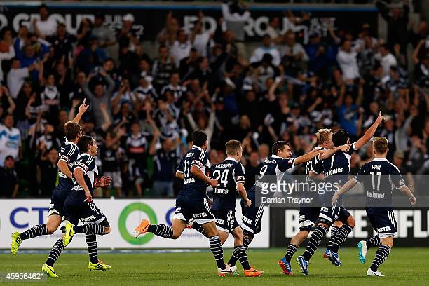 Victory players celebrate a goal during the round 12 ALeague match between Melbourne Victory and the Western Sydney Wanderers at AAMI Park on...