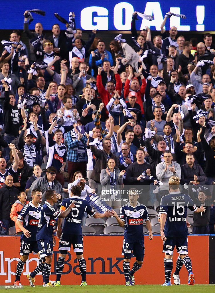 Victory players celebrate a goal during the round four A-League match between Melbourne Victory and Wellington Phoneix at Etihad Stadium on November 4, 2013 in Melbourne, Australia.