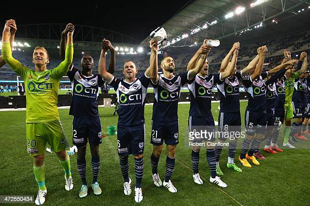 Victory players celebrate after the Victory defeated Melbourne City the ALeague semi final match between Melbourne Victory and Melbourne City at...