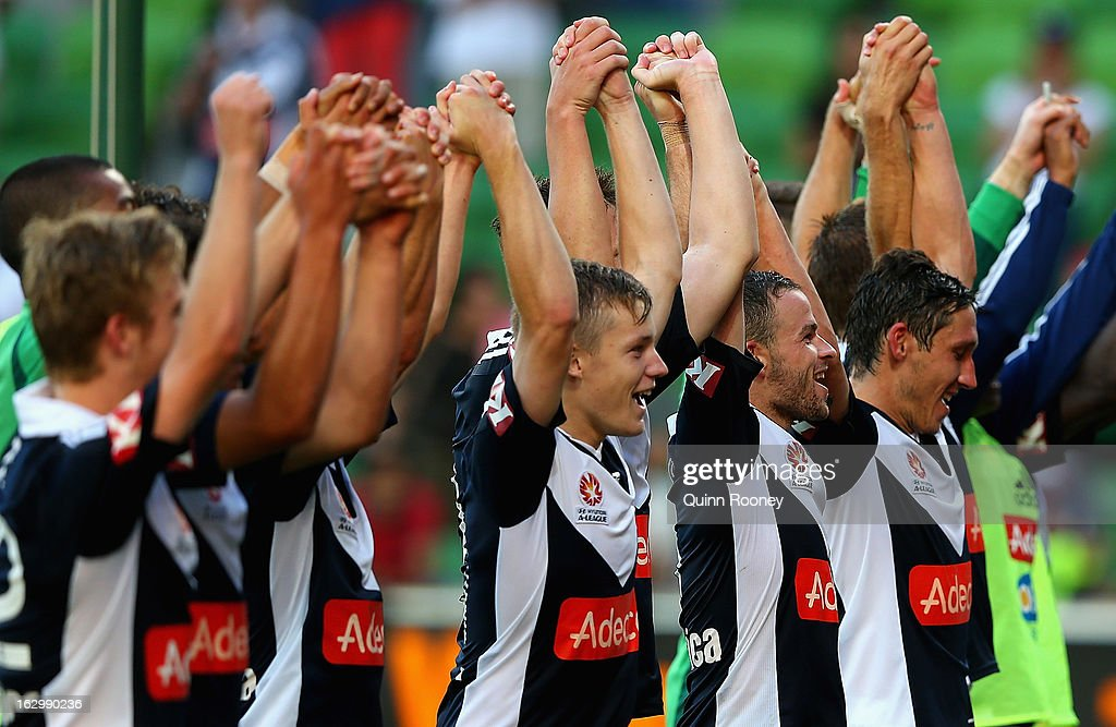 Victory players celebrate winning the round 23 A-League match between the Melbourne Victory and the Newcastle Jets at AAMI Park on March 3, 2013 in Melbourne, Australia.