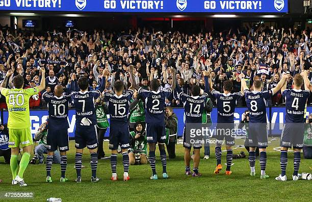 Victory players celebrate with fans after winning the ALeague semi final match between Melbourne Victory and Melbourne City at Etihad Stadium on May...