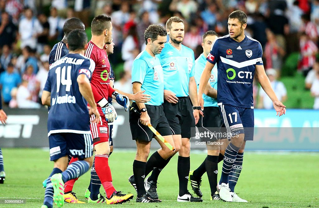 Victory players speak with referee Chris Beath after the final whistle during the round 19 A-League match between Melbourne City FC and Melbourne Victory at AAMI Park on February 13, 2016 in Melbourne, Australia.
