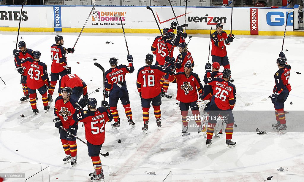 Victory Rats litter the ice as the Florida Panthers salute their fans by raising their sticks at center ice after defeating the New Jersey Devils in Game Two of the Eastern Conference Quarterfinals during the 2012 NHL Stanley Cup Playoffs at the BankAtlantic Center on April 15, 2012 in Sunrise, Florida. The Panthers defeated the Devils 4-2.
