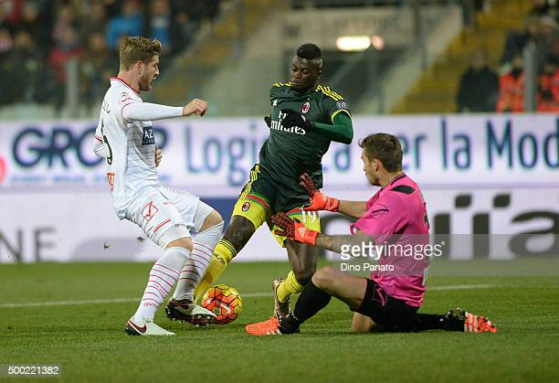 Vid Belec goalkeeper of Carpi saves a shot from Mabaye Niang of Milan during the Serie A match between Carpi FC and AC Milan at Alberto Braglia...