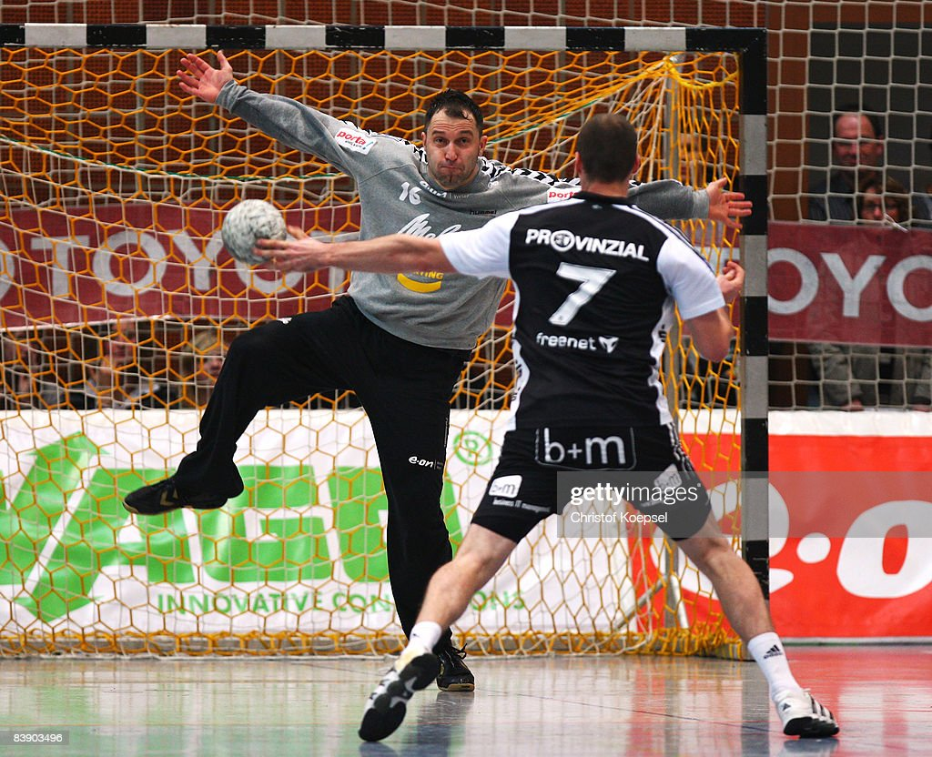 Vid Kavticnik of Kiel scores a seven meter shoot against Mailk Besirevic of Minden during the Bundesliga match between GWD Minden and THW Kiel at the...