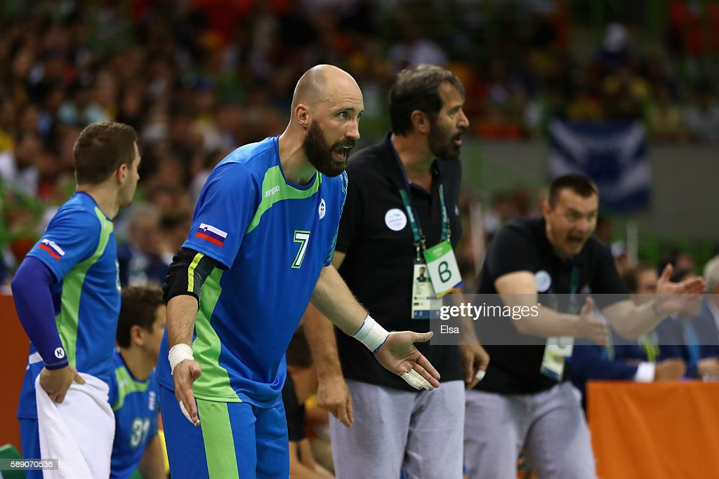 Vid Kavticnik of Slovenia and his team mates react during the Men's Handball preliminary Group B match between Slovenia and Germany on Day 8 of the...