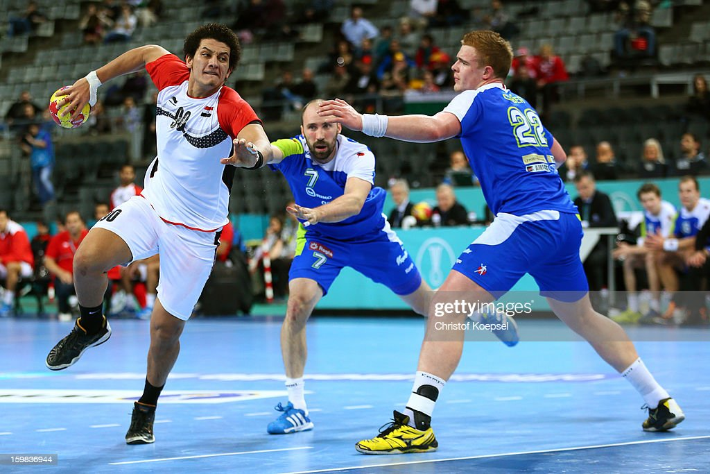 Vid Kavticnik of Slovenia and Matej Gaber of Slovenia defend against Ali Zein of Egypt during the round of sixteen match between Slovenia and Egypt...