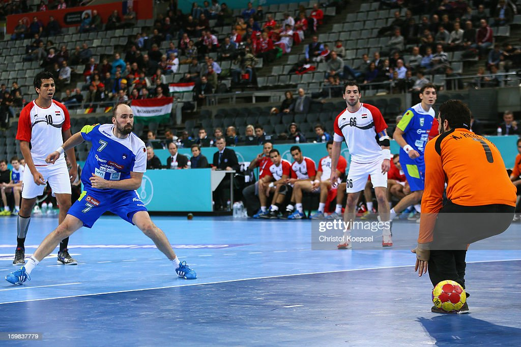 Vid Kavticnik of Slovenia failes against Karim Mostafa of Egypt during the round of sixteen match between Slovenia and Egypt at Palau Sant Jordi on...