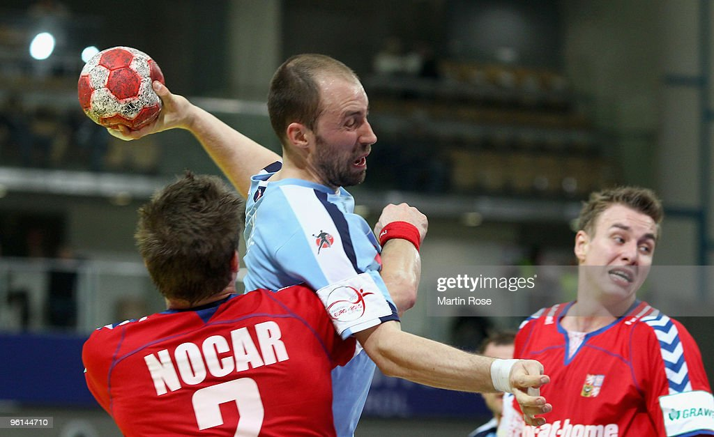 Vid Kavticnik of Slovenia in action with Karel Nocar of Czech Republic during the Men's Handball European main round Group II match between Slovenia...