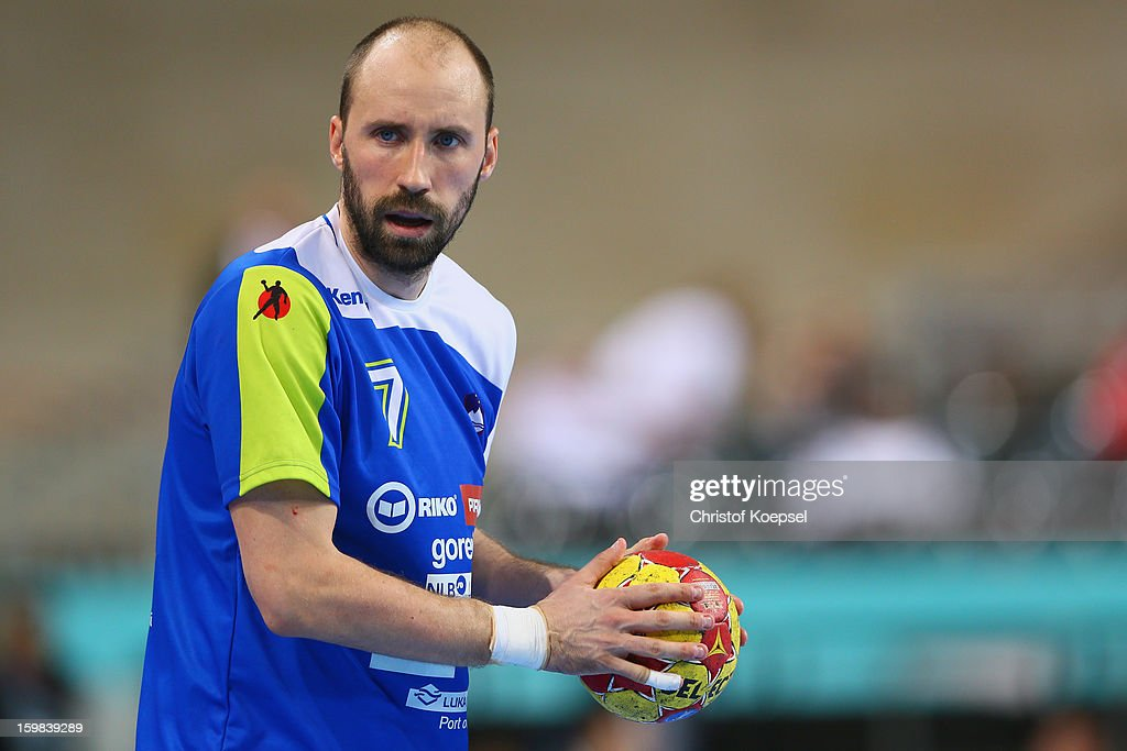 Vid Kavticnik of Slovenia passes the ball during the round of sixteen match between Slovenia and Egypt at Palau Sant Jordi on January 21 2013 in...
